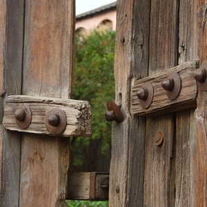 a rustic wooden gate opening into a garden